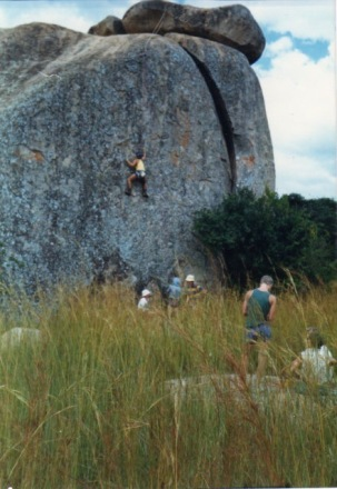 Me climbing at the Balancing rocks about 1991 (both in in a greener state). Zoomed in, I notice the most awesome, respected Jack Robinson in striped shirt: One of very few people to mitigate the wreck of my secondary school education.